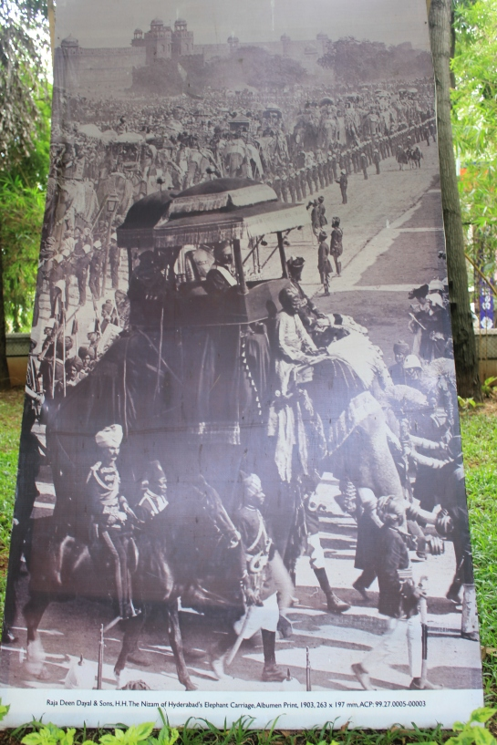 A hoarding at the NGMA with a picture of the Nizam's Elephant Carriage, 1903.