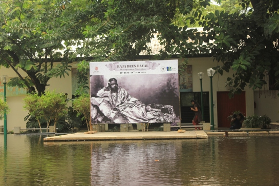 A photo by Raja Deen Dayal adorns an exhibition hoarding at the NGMA.