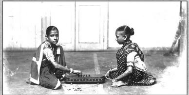 Women playing a board game (Picture courtesy: NGMA)