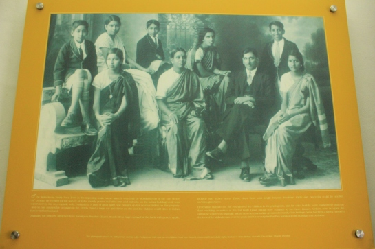 The sepia-toned family photo of Mr Mahadevan adorns the reception of Basava Ambara