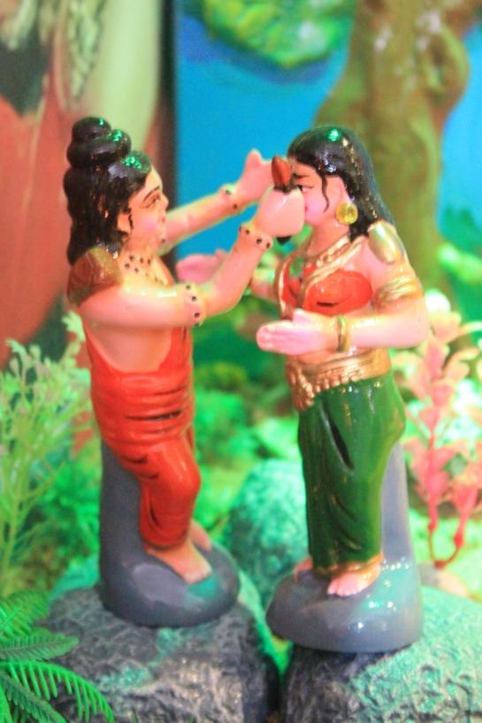 Lakshmana chops off demoness Shurpanakha's nose.
