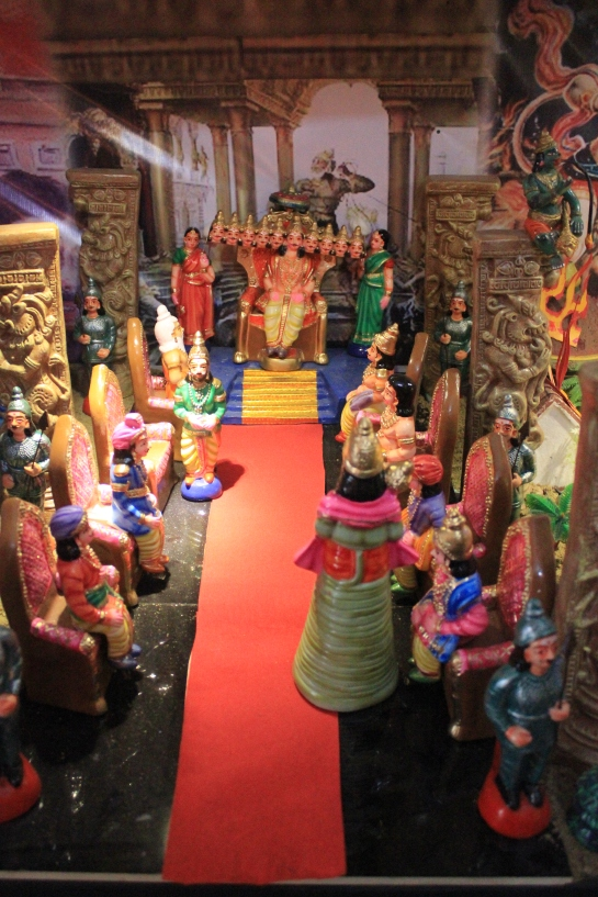 Hanuman is brought to Ravana's court.