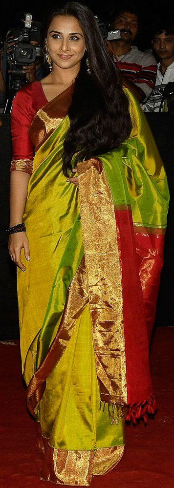 Vidya Balan looks resplendent in a green zari-border silk saree with a red palu. (Pic courtesy: Vidya Balan's Facebook page)
